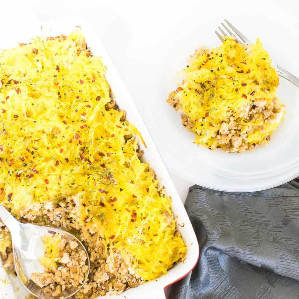 top view of the spaghetti squash casserole served on a plate from the baking dish.
