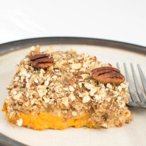 scooped vegan sweet potato casserole on a serving plate.