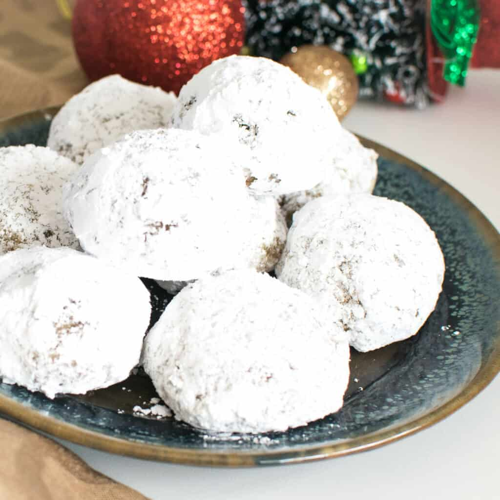 a 45 degree angle view of stacked snowball cookies.