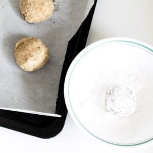rolling in powdered sugar.