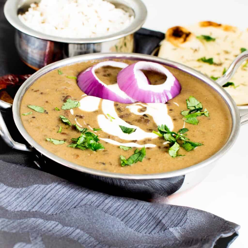 a front view of served dal makhani.