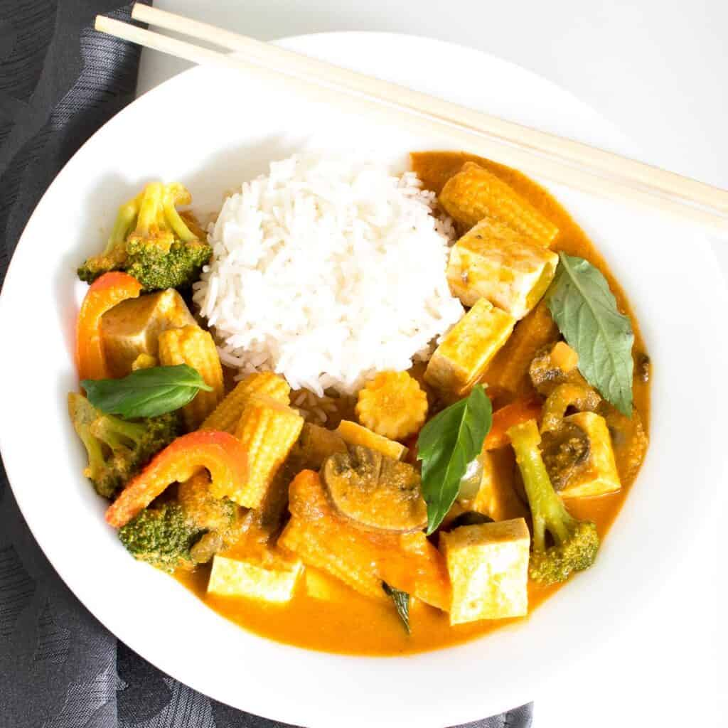 top view of Thai red curry vegetables served with rice.