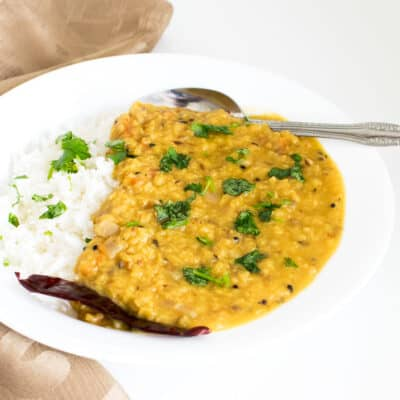 a 45 degree angle view of red lentil dal.