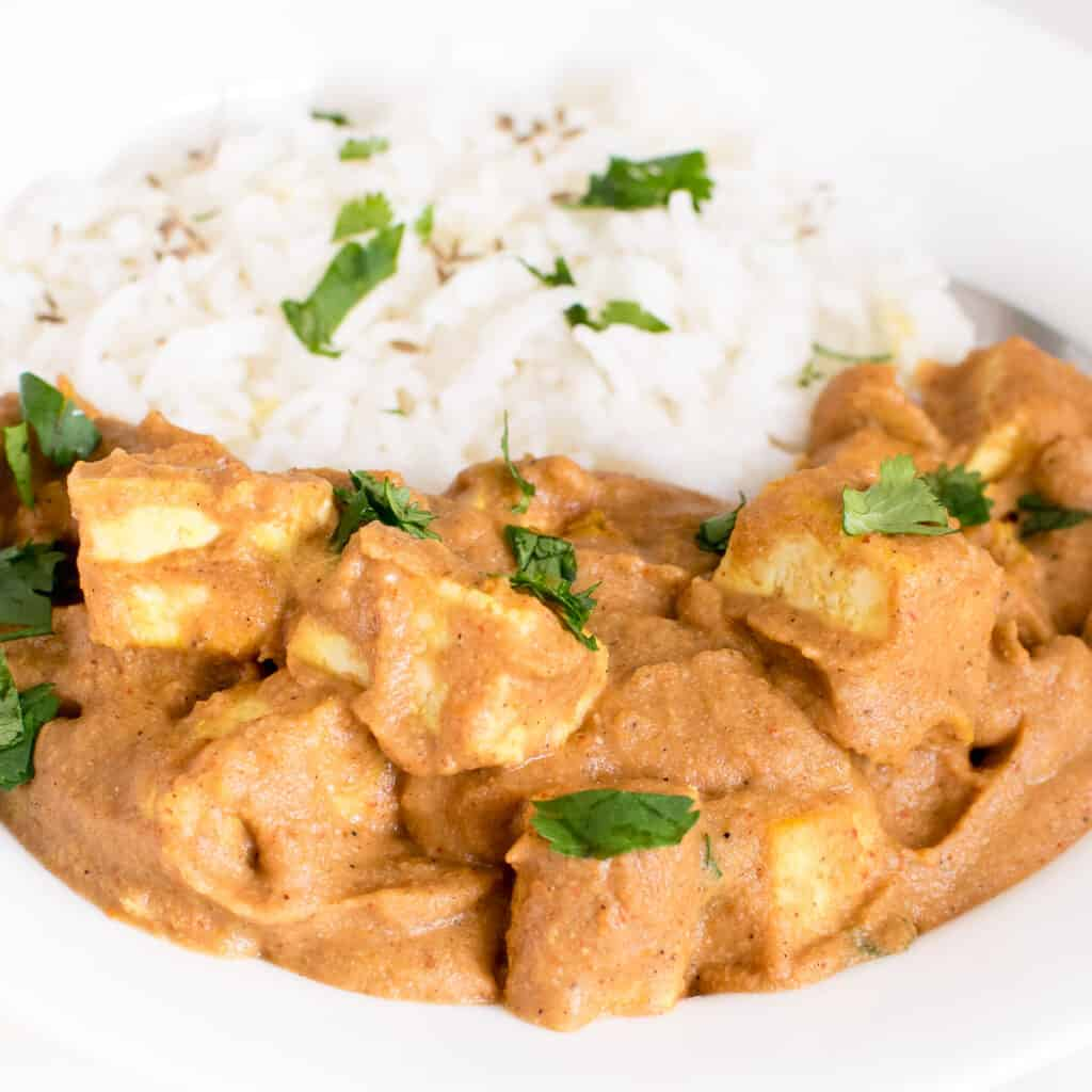 a close up view of tofu tikka masala in a serving plate.
