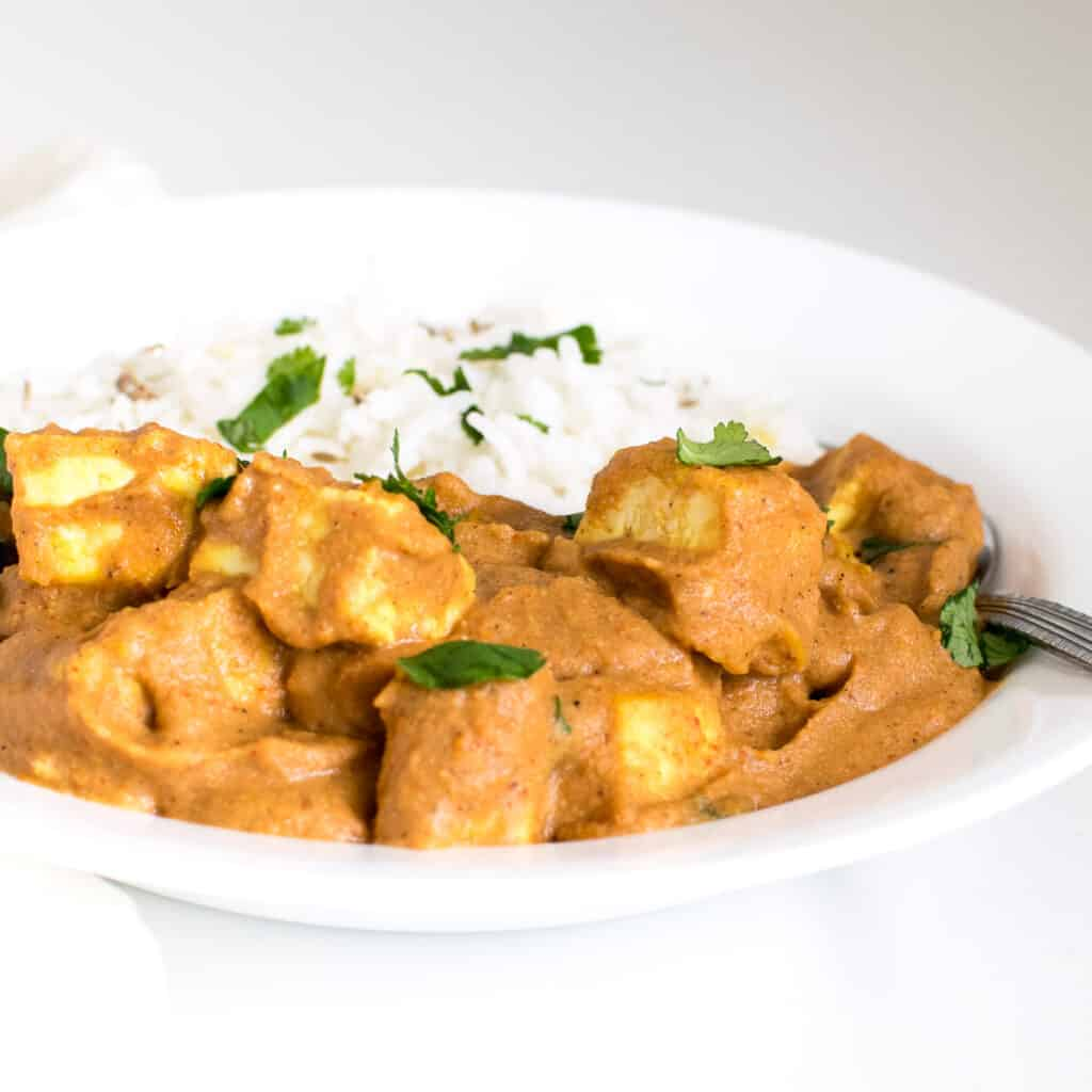 a front view of tofu tikka masala in a serving plate.
