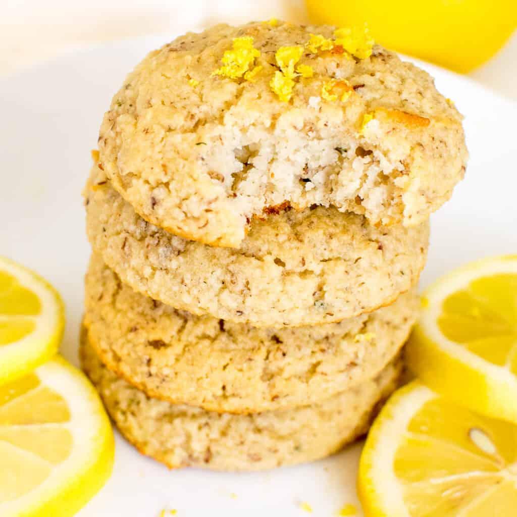 a 45 degree angle view of half eaten vegan lemon cookies.