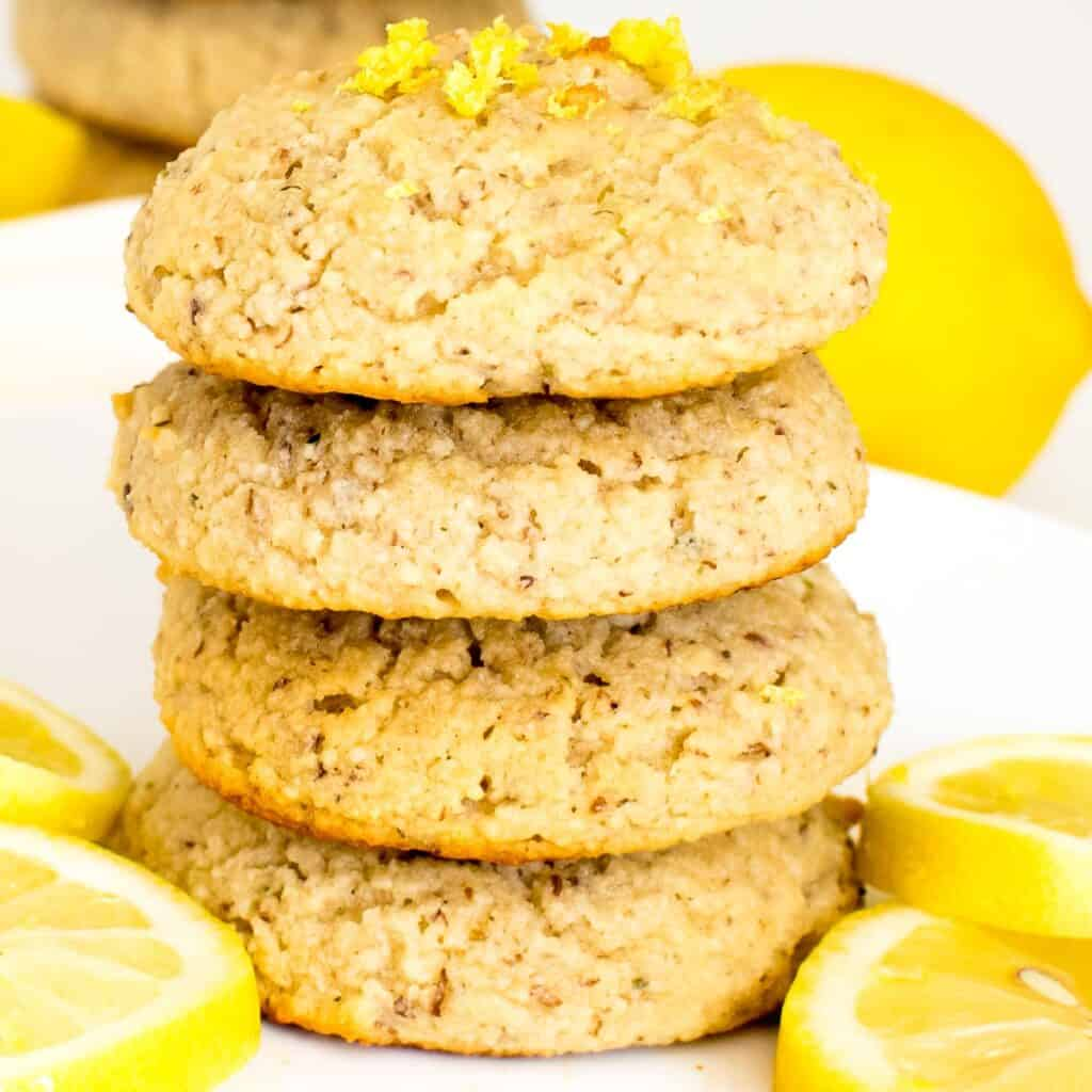 a close up view of stacked vegan lemon cookies