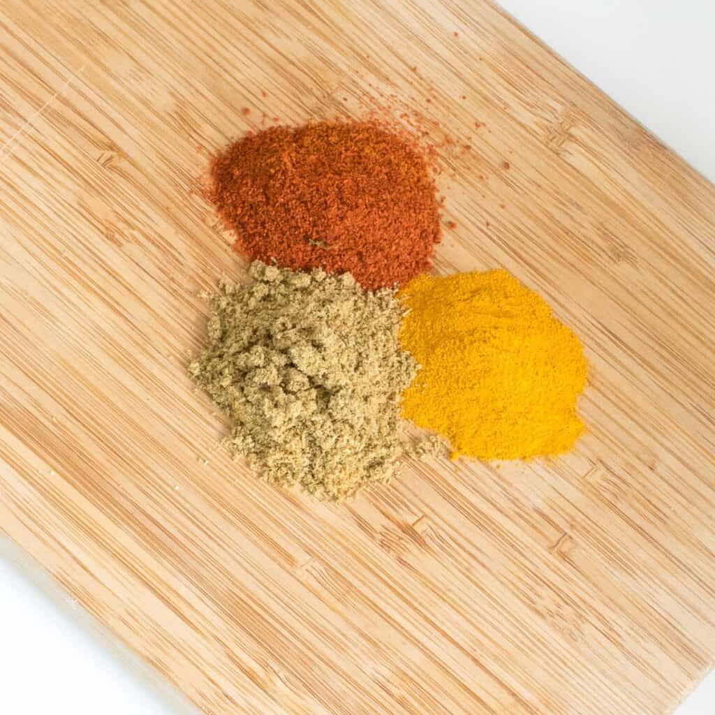 top view of the spices on a wooden board.