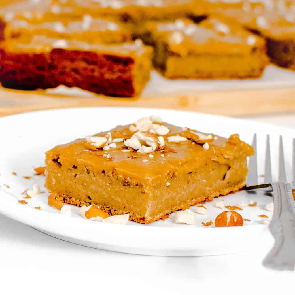 a front view of the entire peanut butter cake slice on a serving plate.