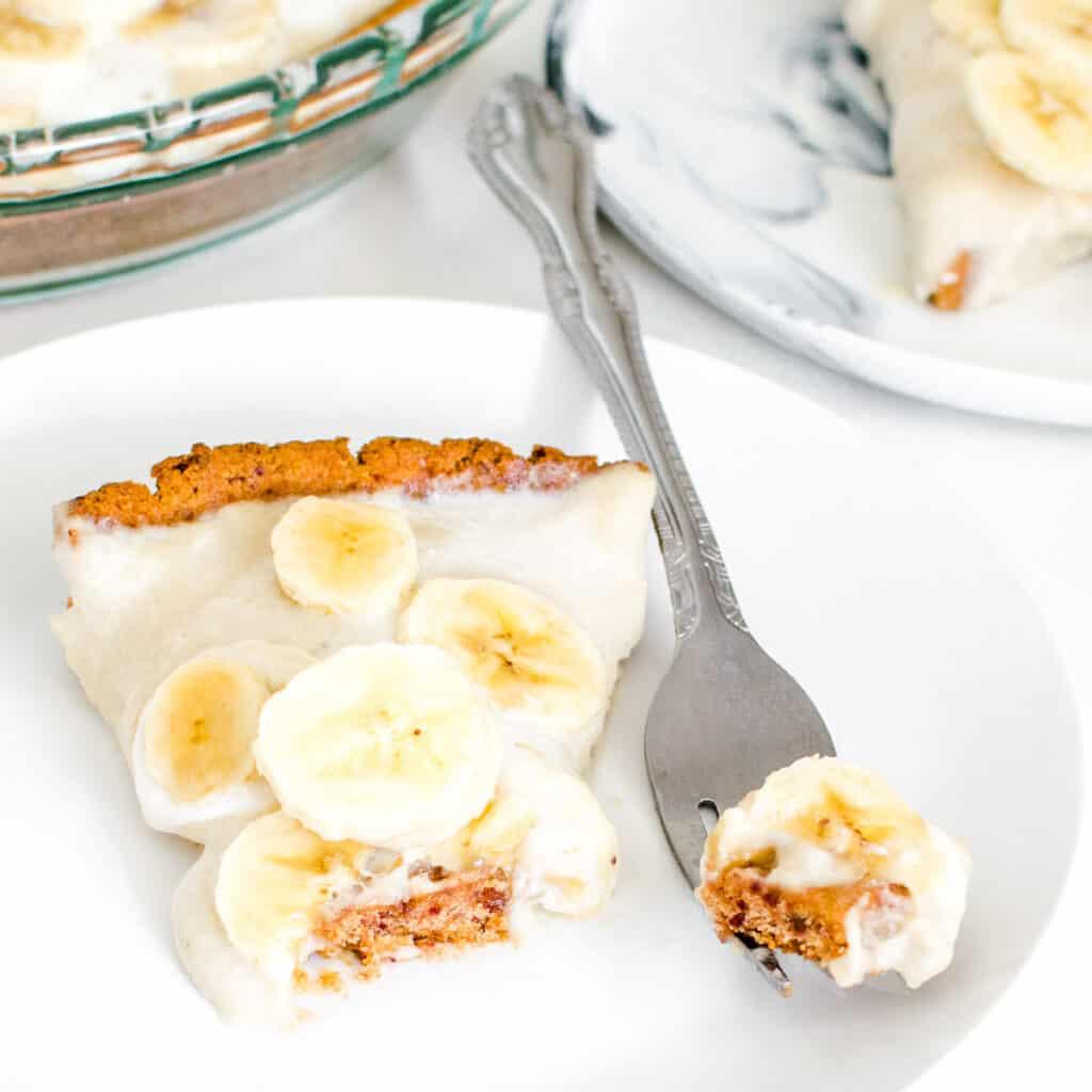 a fork with a piece of vegan banana cream pie.