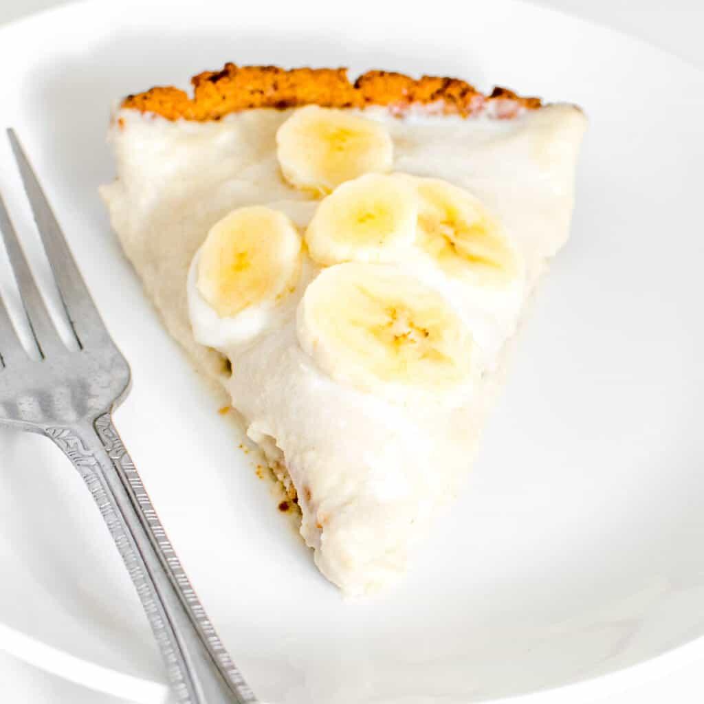 a close up 45 degree angle view of sliced vegan banana cream pie.