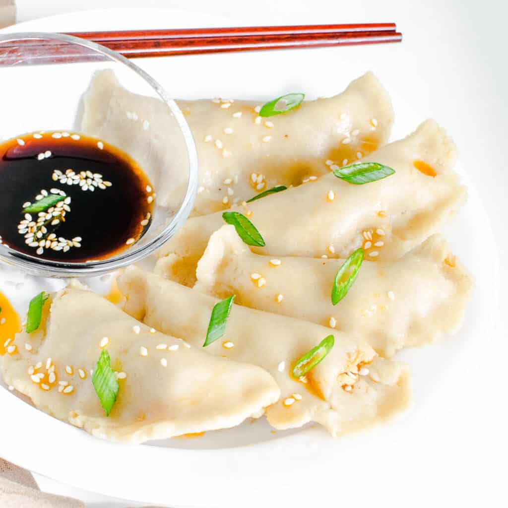 a 45 degree angle view of served vegan dumplings.