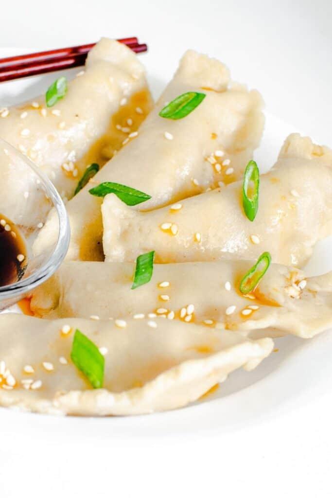 served vegan dumplings with the chopsticks.