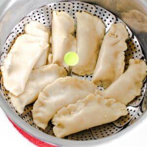 steamed vegan dumplings in the vegetable steamer.