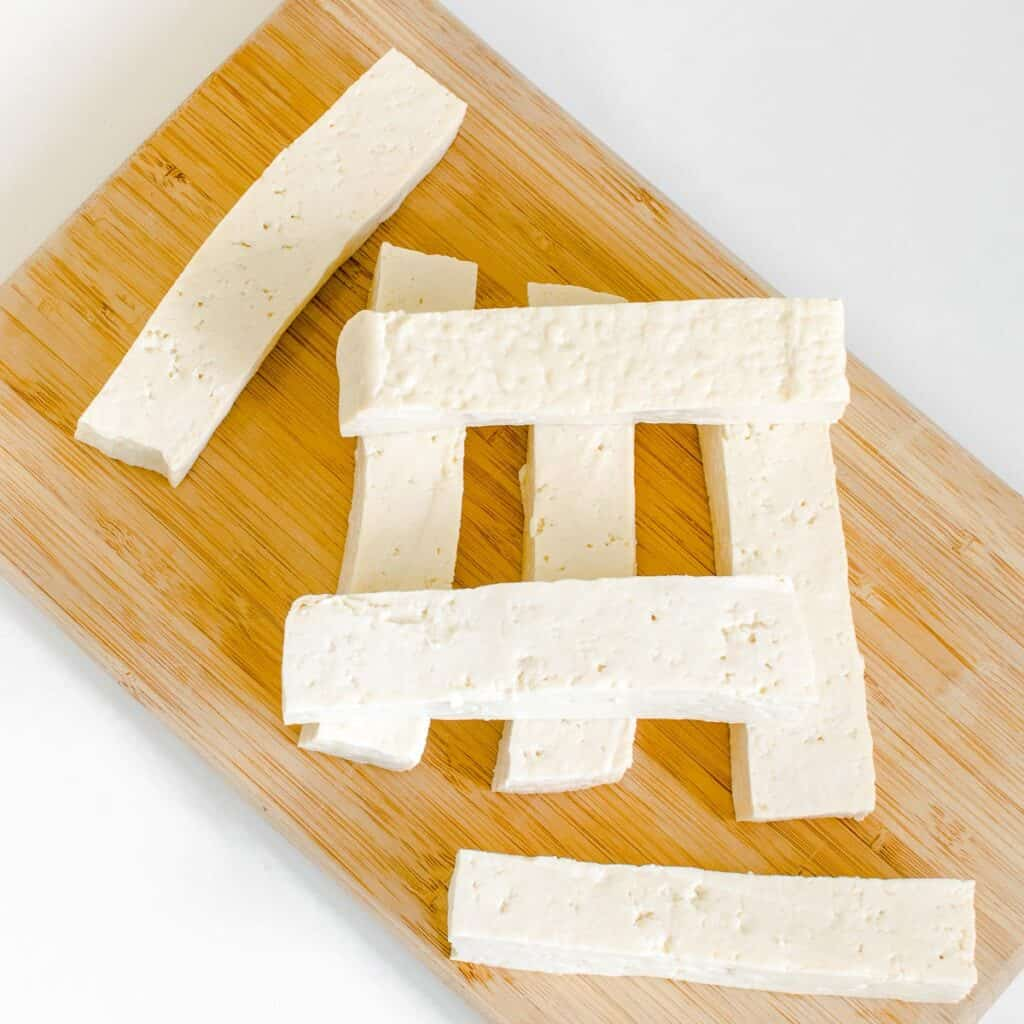sliced tofu on a wooden board.