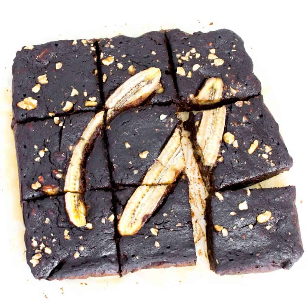 top view of sliced banana brownies with scattered pieces.