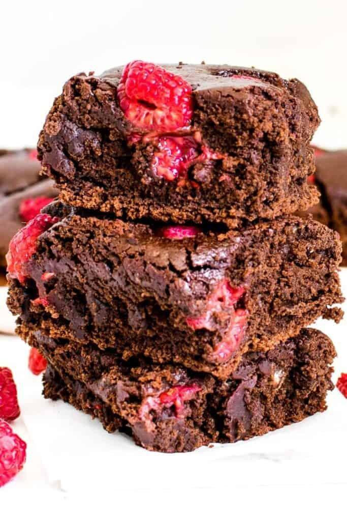 a close view of stacked raspberry brownies.