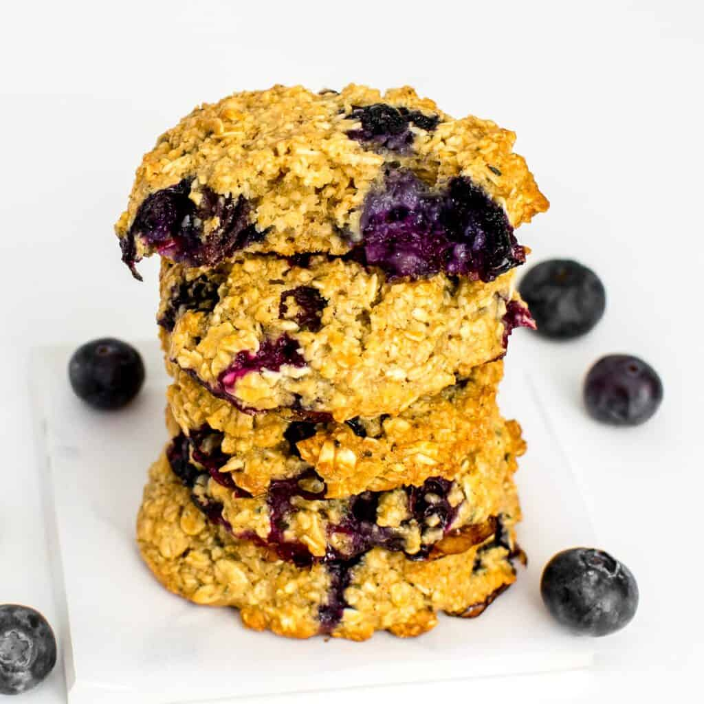 half eaten blueberry oatmeal cookies at the top of its stack.