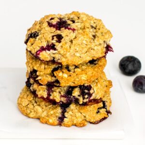 a 45 degree angle view of stacked blueberry oatmeal cookies.
