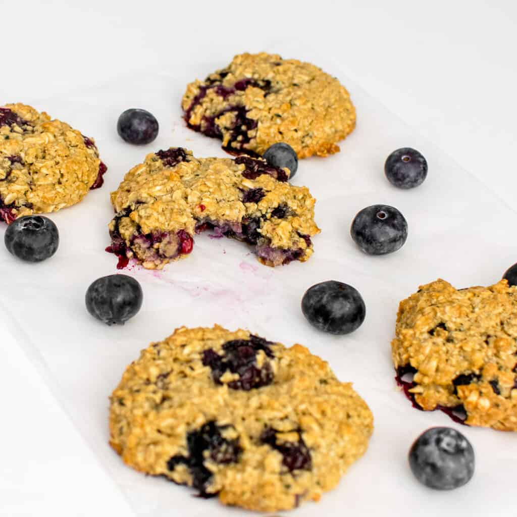 a close up view of half eaten blueberry oatmeal cookies.
