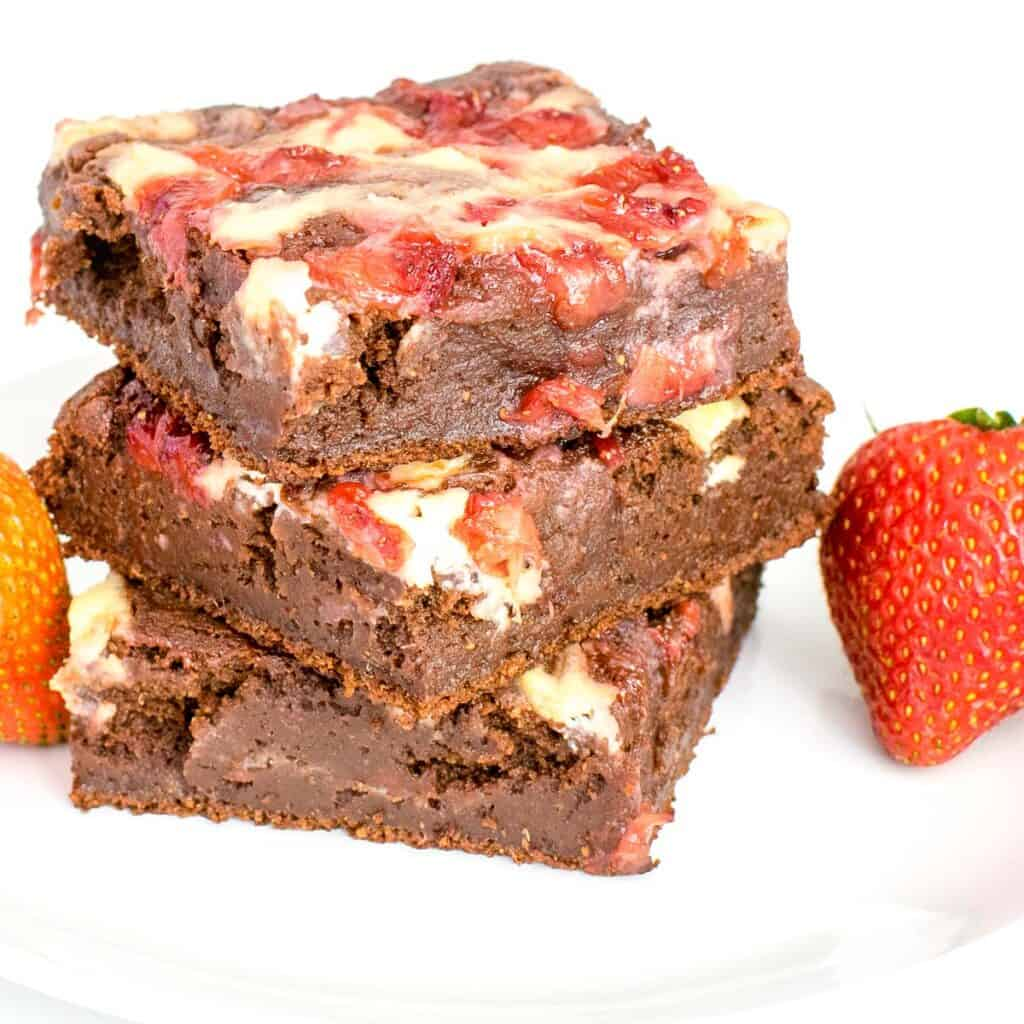 front view of stacked strawberry cheesecake brownies.