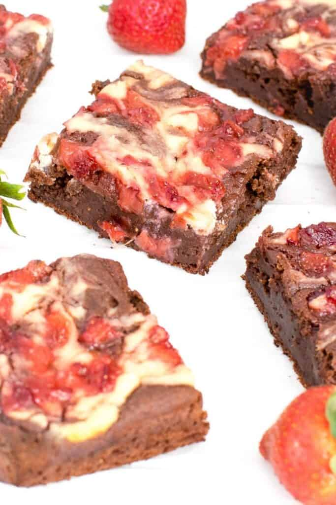 a 45 degree angle view of strawberry cheesecake brownies slices.