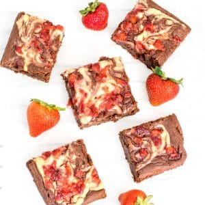 top view of scattered sliced strawberry cheesecake brownies.