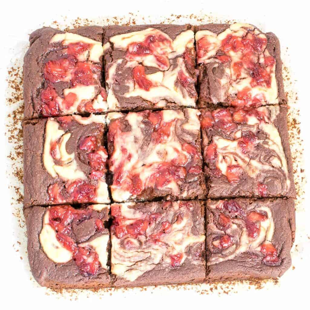 top view of sliced strawberry cheesecake brownies.