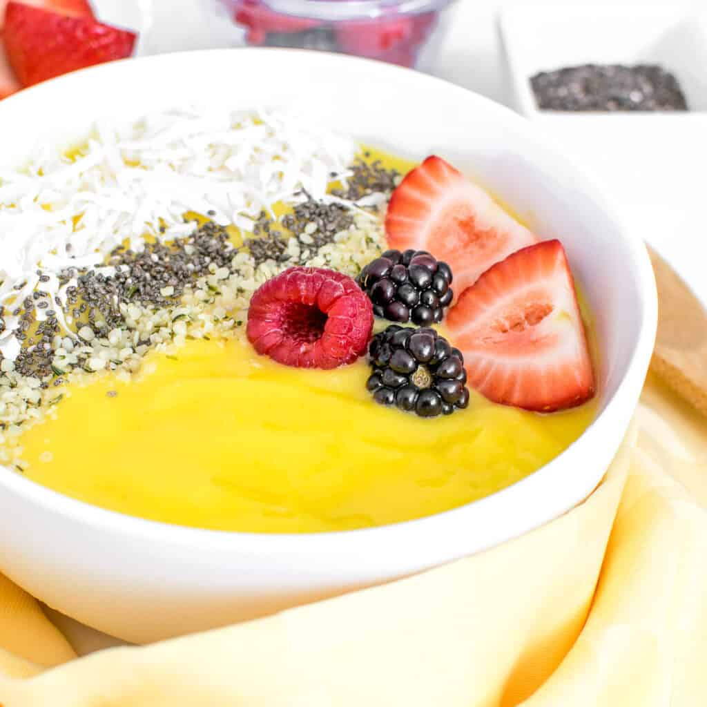 a front view of mango smoothie bowl.