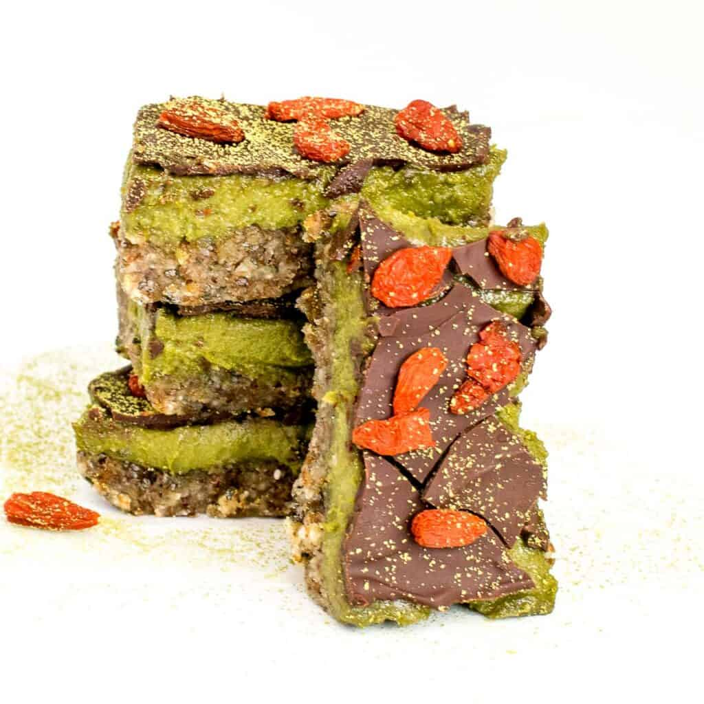 a stack of matcha bars supporting one in the front.