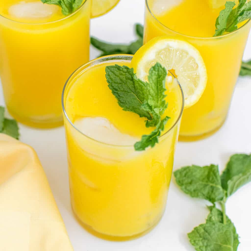 a 45 degree close up view of mango lemonade.