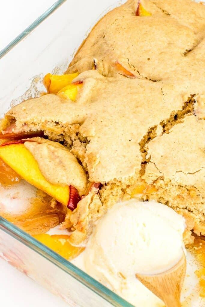 vegan peach cobble with vegan vanilla ice cream.