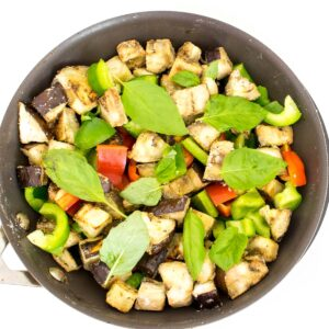 all the vegetables and herb in the pan