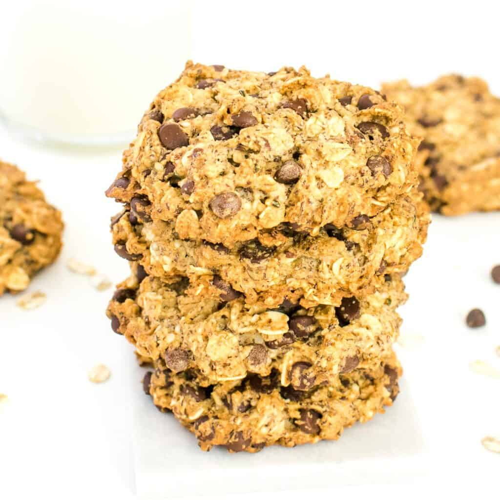 a front view of stacked vegan oatmeal chocolate chip cookies.