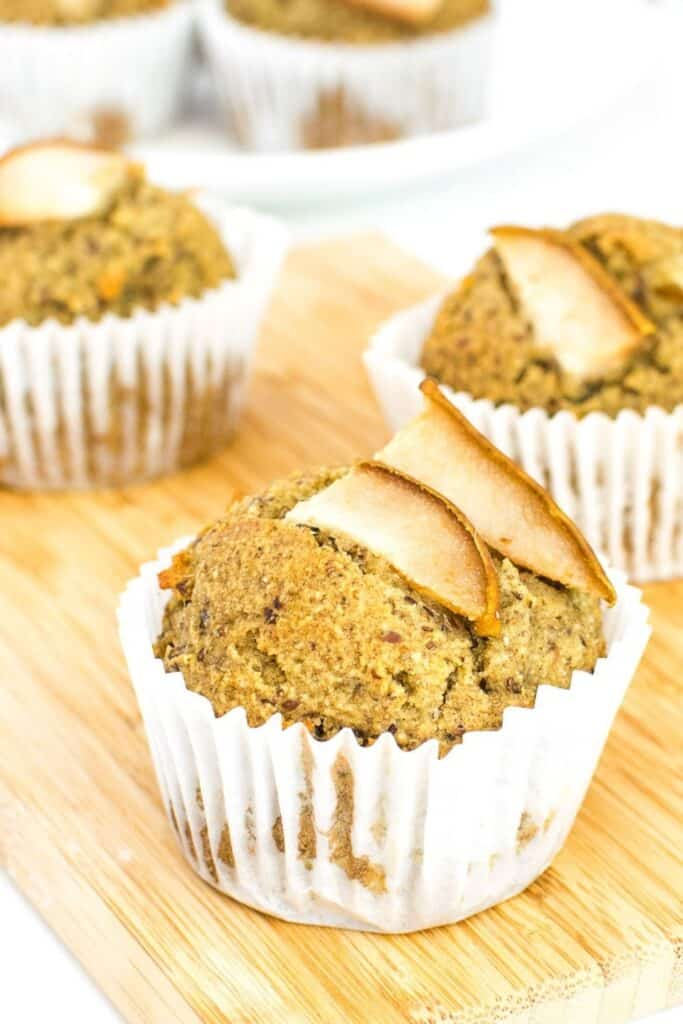 pear muffins on a wooden board.