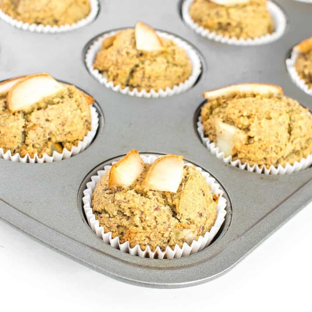 a 45 degree angle view of pear muffins in the tray.