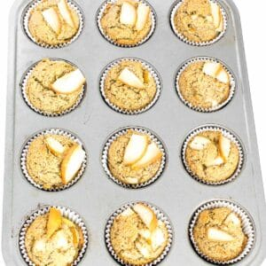 fresh baked pear muffins in the tray