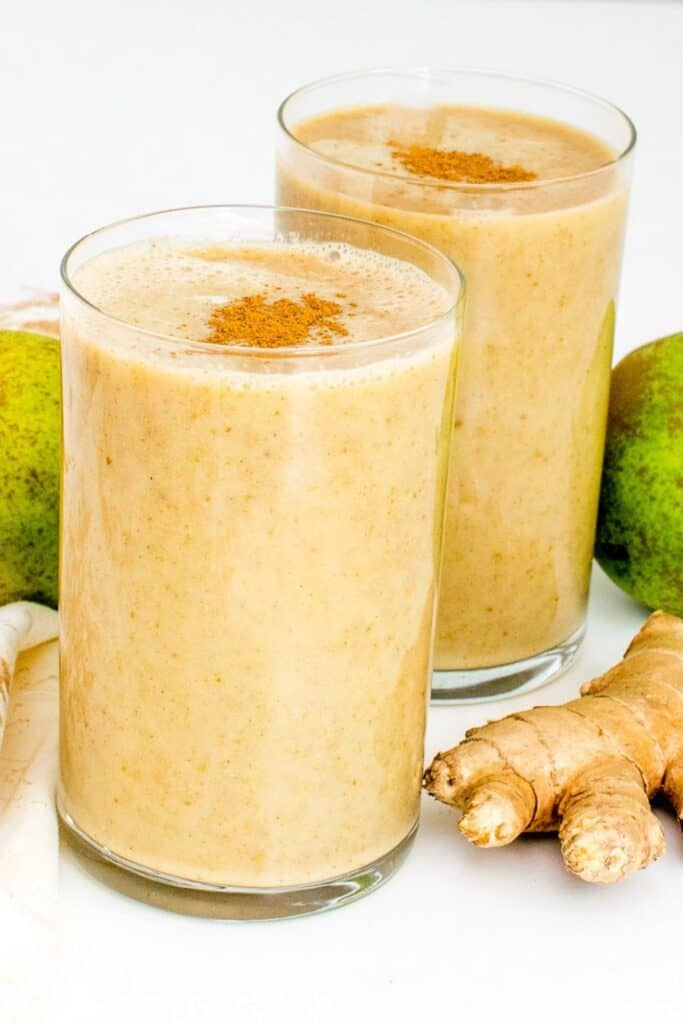 tall glasses filled with pear smoothie.