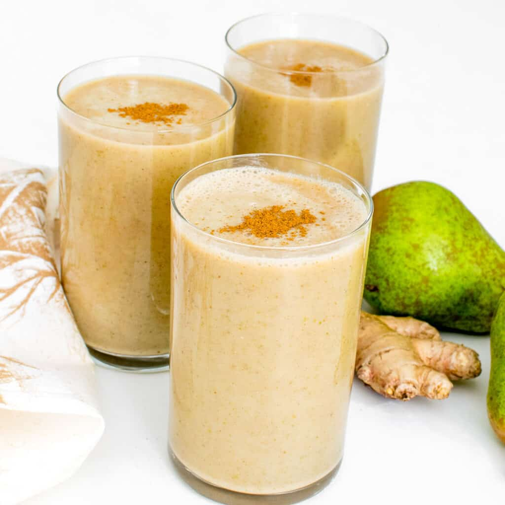 front view of pear smoothie in the serving glasses