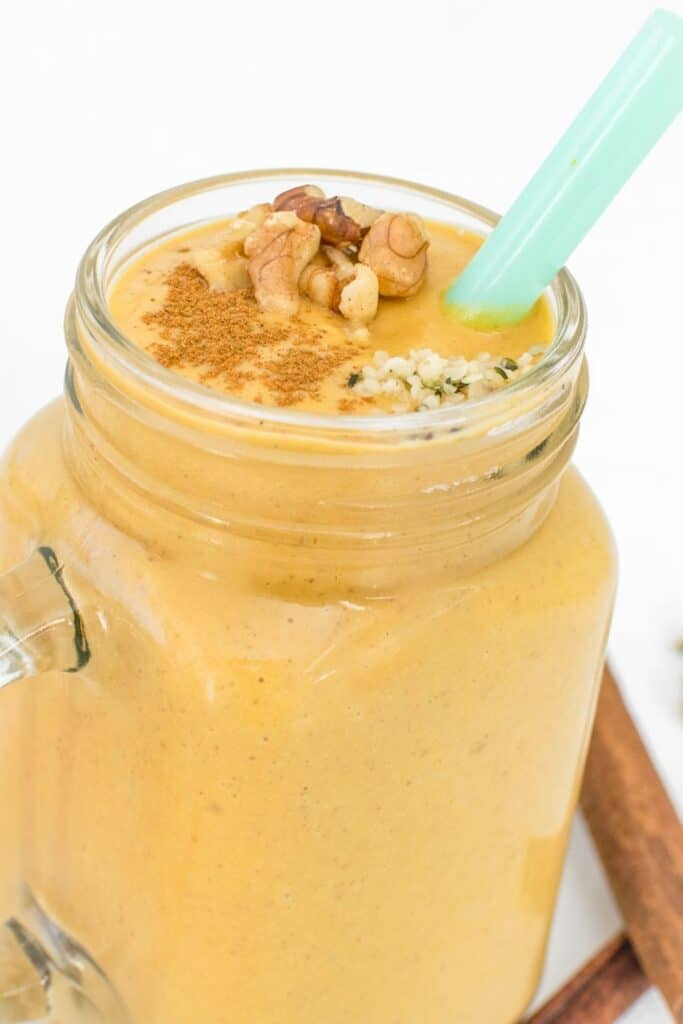 front view of a glass filled with sweet potato smoothie.
