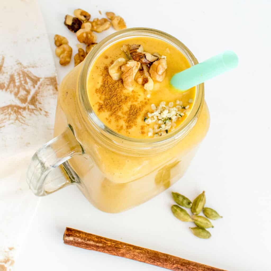top view of a glass filled with sweet potato smoothie.