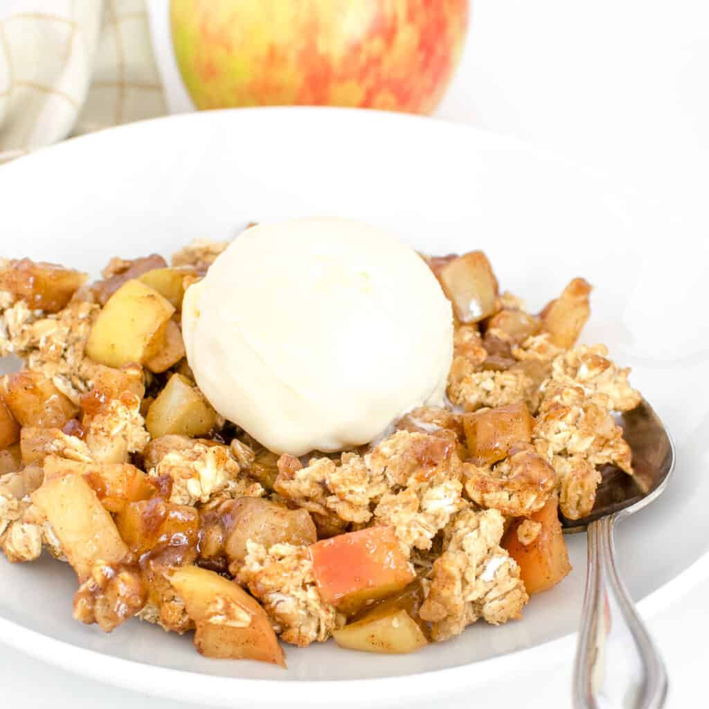 a front view of vegan apple crisp with ice cream