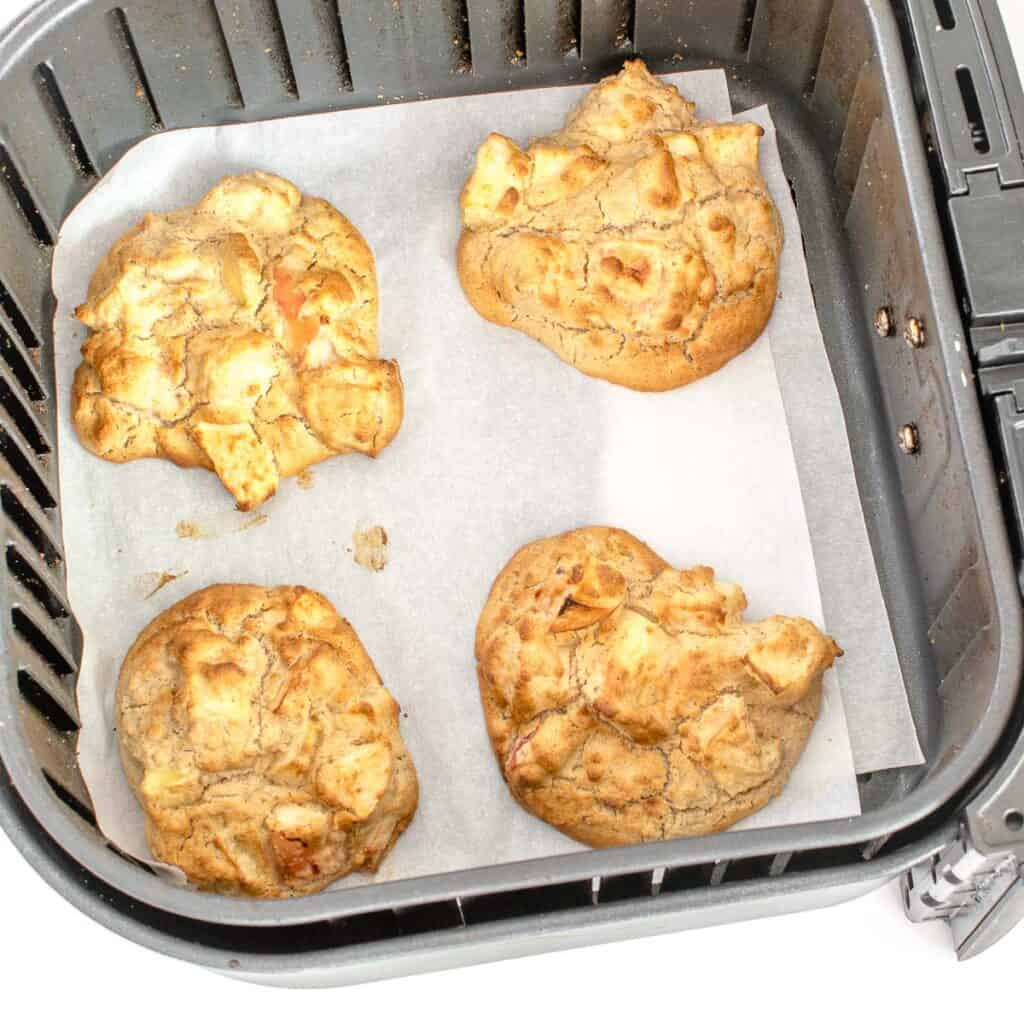 air fryer apple fritters in the basket.