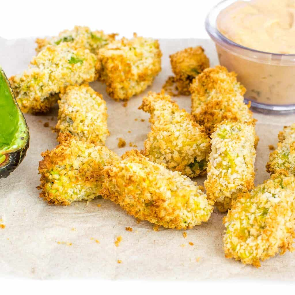 front view of air fryer avocado fries.