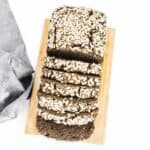 top view of sliced buckwheat bread on a wooden board.