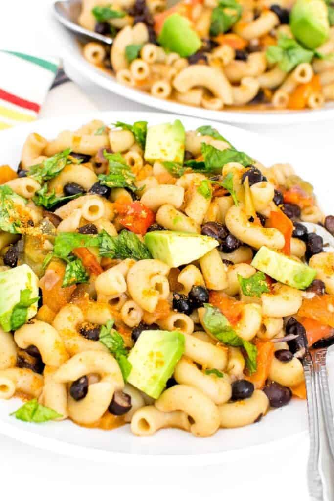 instant pot taco pasta served with garnishes.