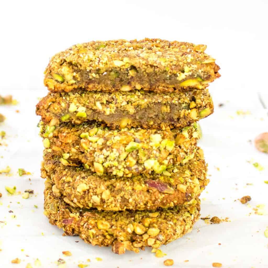 broken pistachio cookies stacked to show its inside.